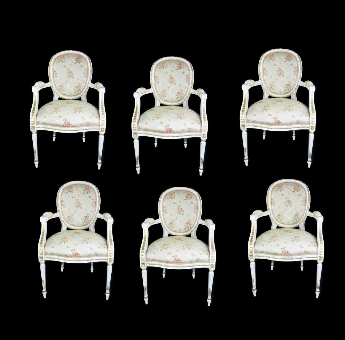 SIX LOUIS XVI STYLE PAINTED AND GILT DINING CHAIRS