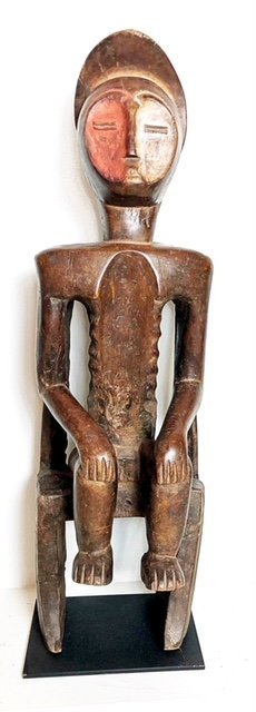 AFRICAN CARVED WOOD SEATED MALE FIGURE