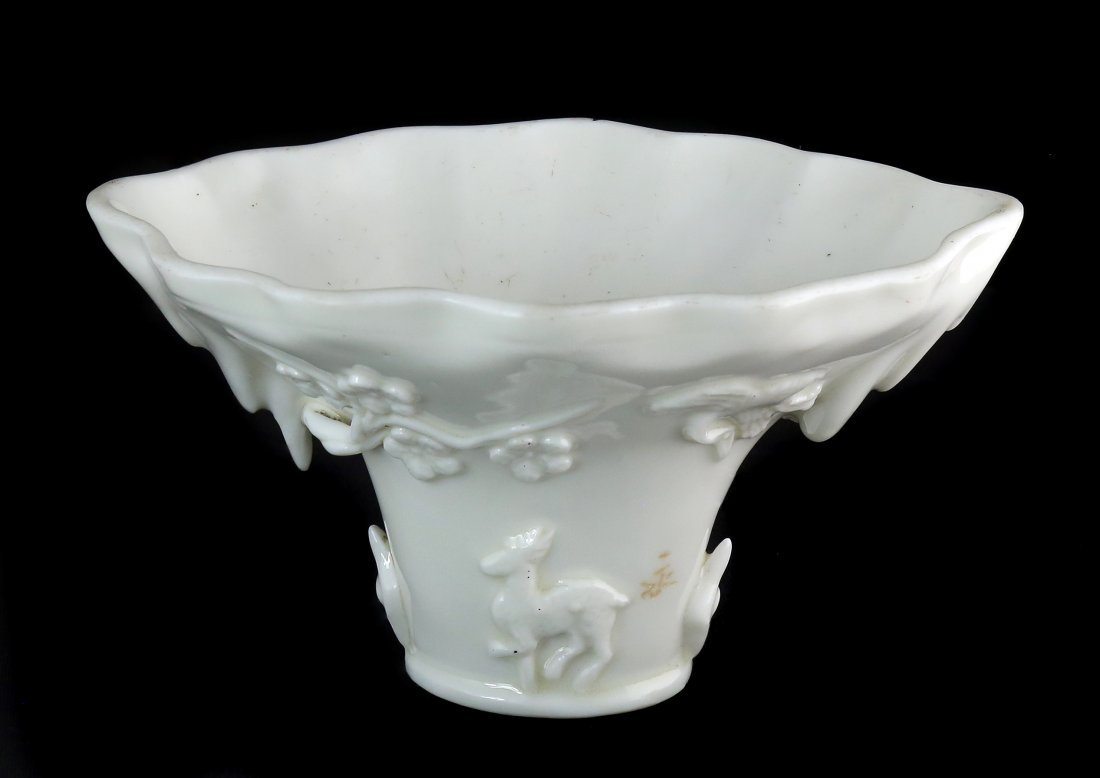 A BLANC-DE-CHINE LIBATION CUP, CHINESE