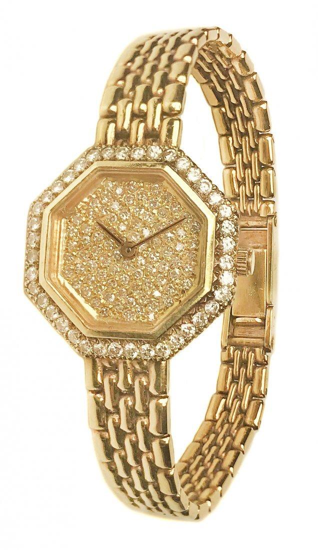 A LADY'S YELLOW GOLD AND DIAMOND  BRACELET WATCH