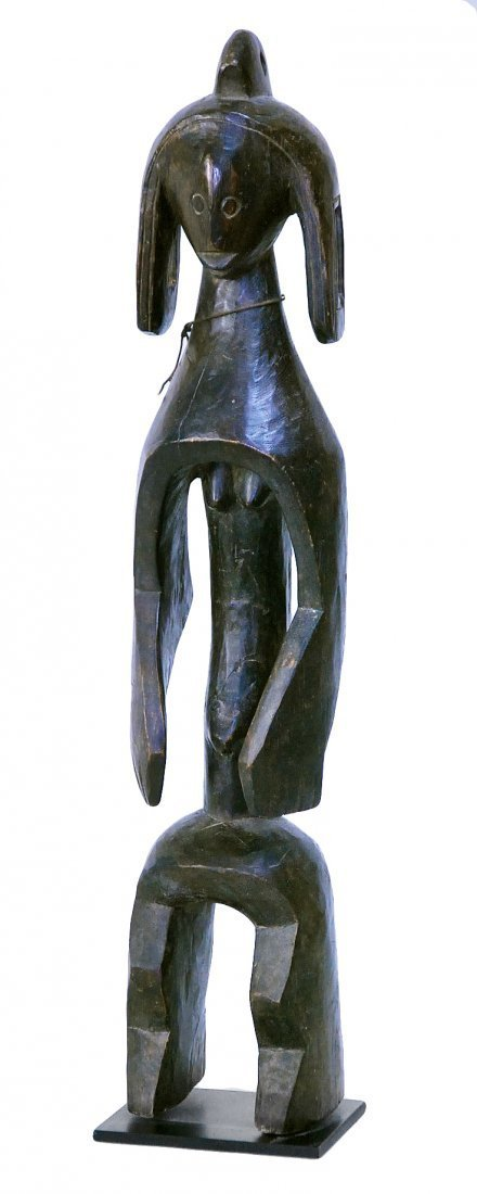 STYLE OF GUARDIAN FIGURE - CARVED WOOD.