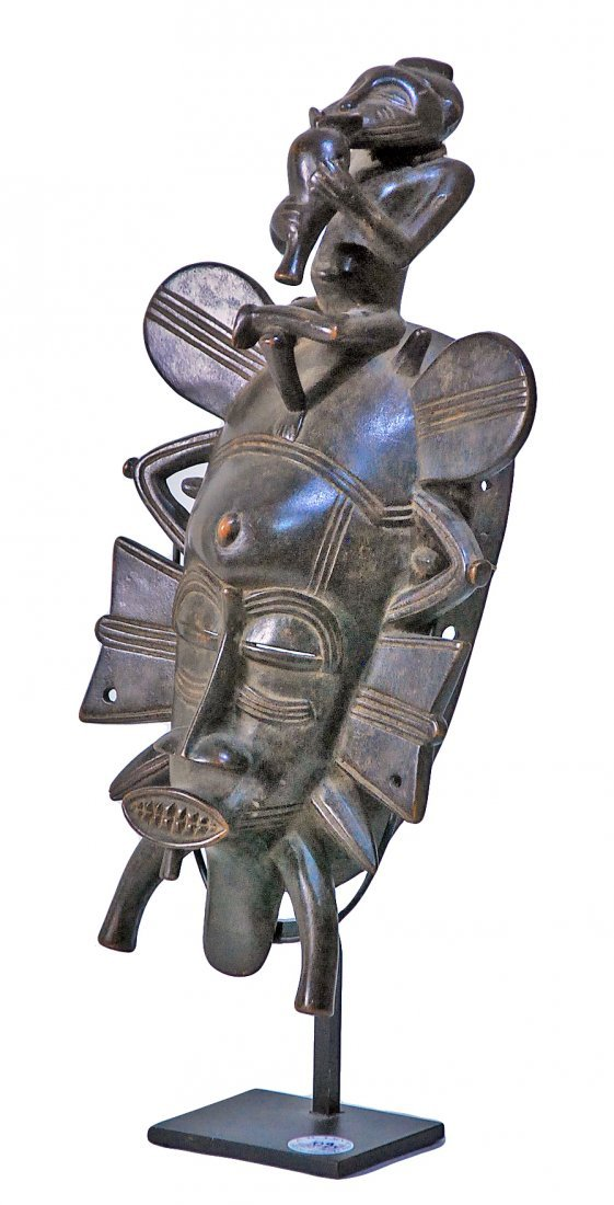 STYLE OF SENUFO PEOPLE KEPELE MASK WITH FLUTE PLAYER