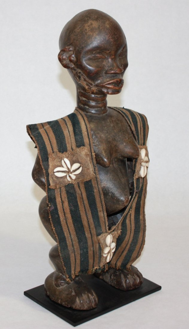 STYLE OF MALE ANCESTRAL FIGURE - CARVED WOOD.