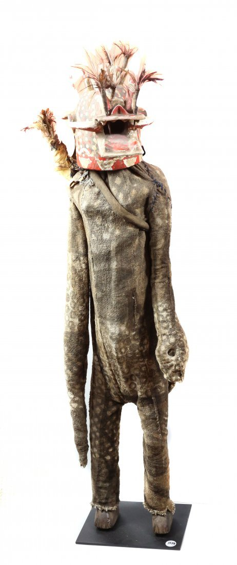 STYLE OF FIRE SPITTER MASKED TOTEM FIGURE - CARVED WOOD