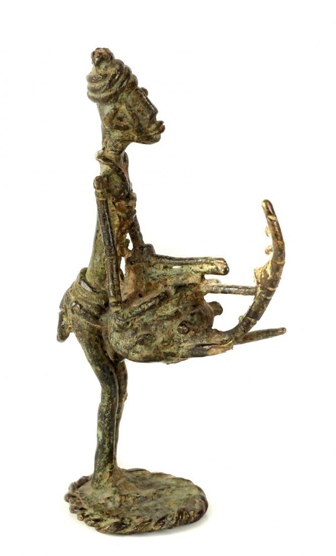 STYLE OF MALE TOTEM FIGURE - BRONZE