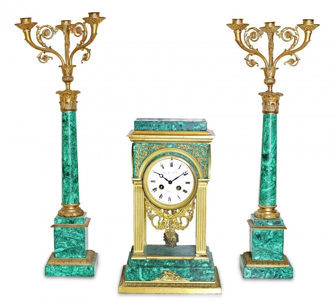 LOUIS XVI STYLE THREE-PIECE MALACHITE CLOCK GARNITURE