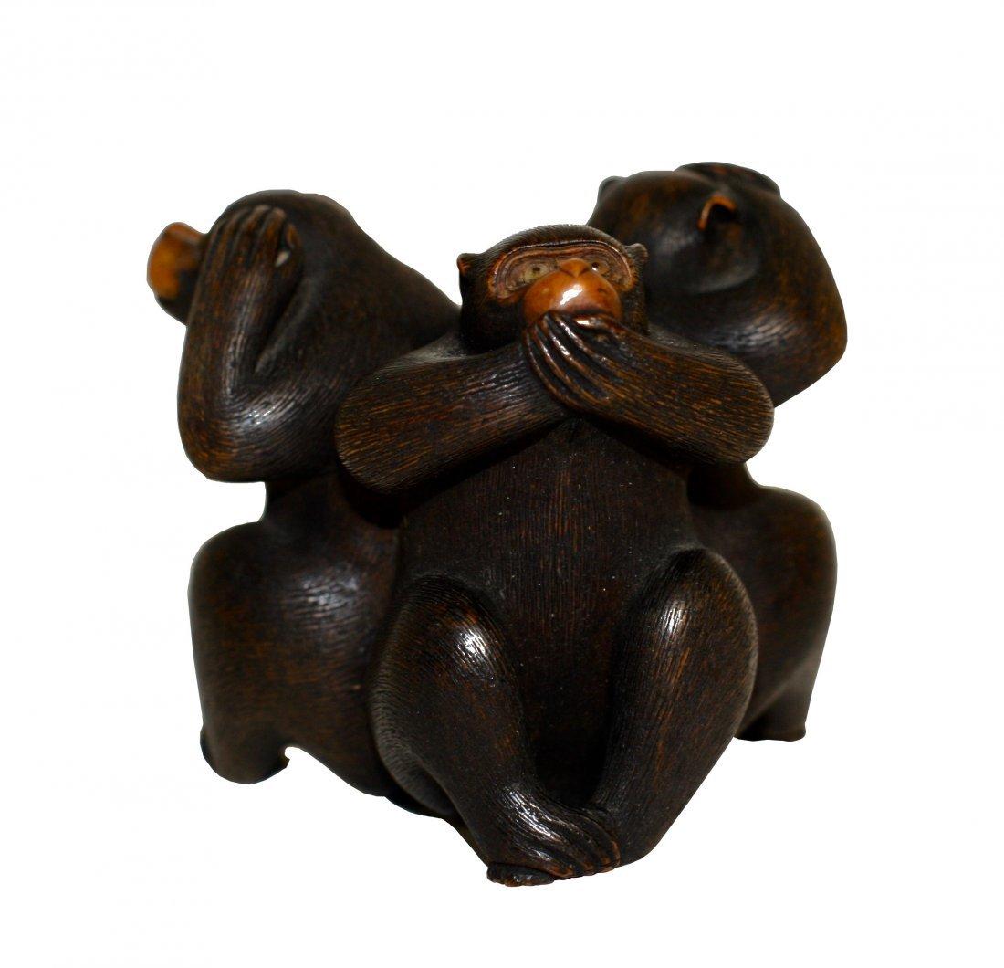A Japanese Wood Okimono of Three Monkeys