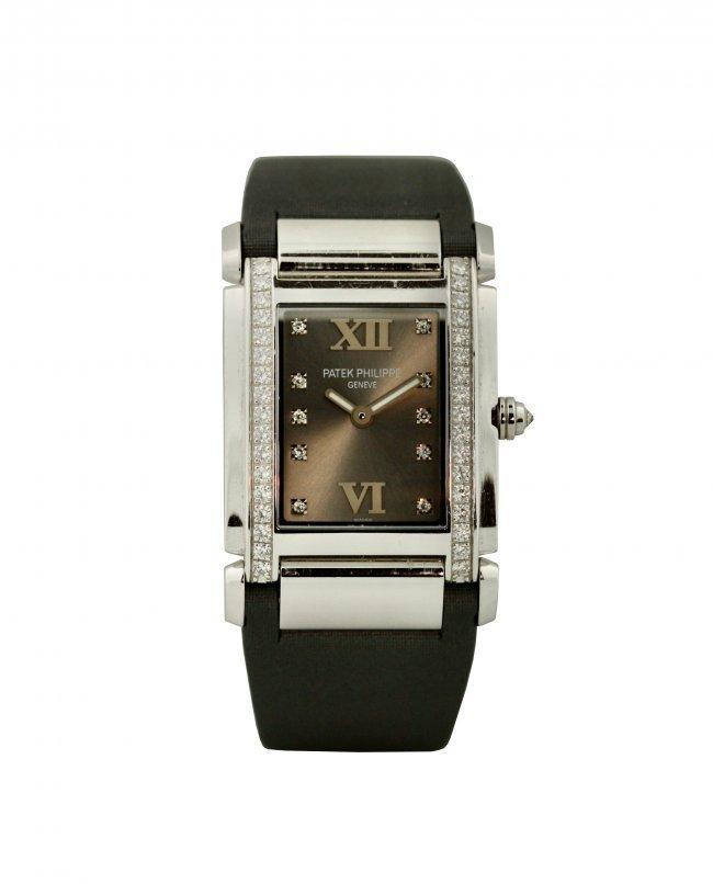 Patek Philippe,  White Gold and Diamond-set Wristwatch