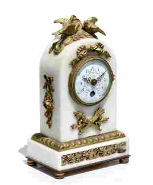 A Louis XVI Style Gilt Bronze and White Marble Clock