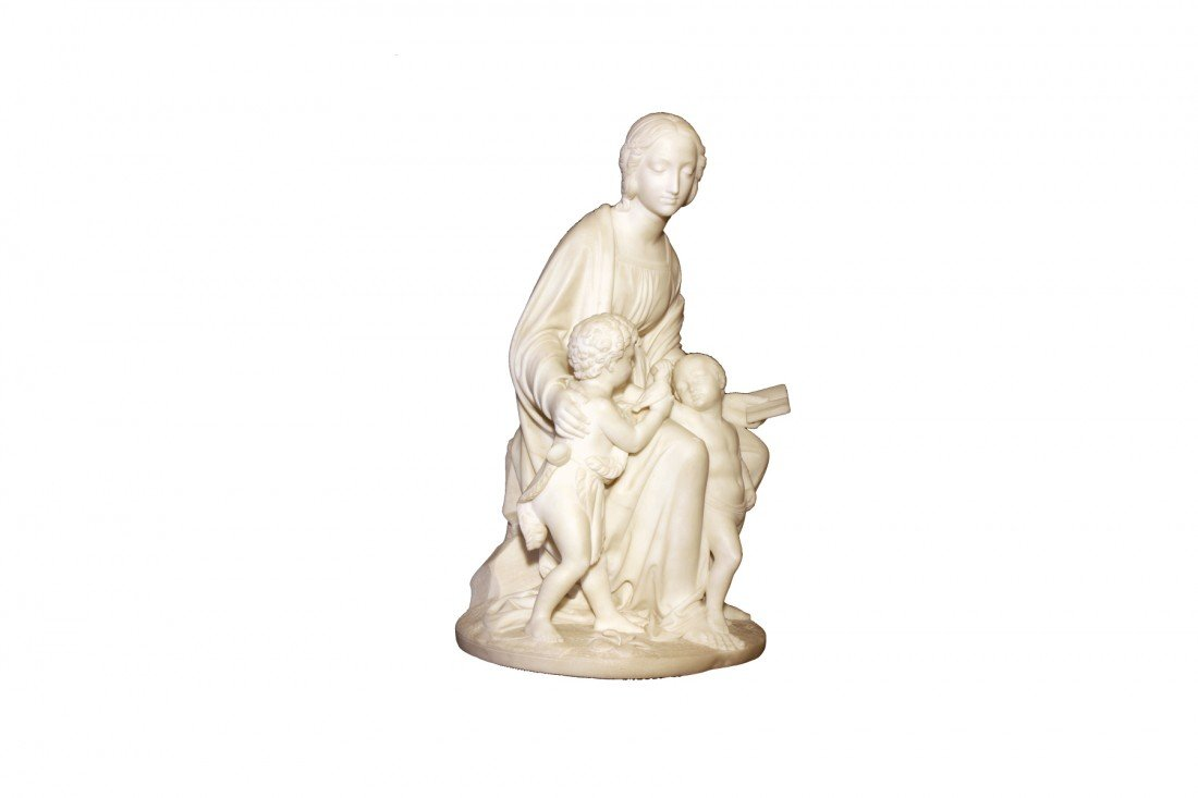 An Italian white marble group of the Madonna and Ch