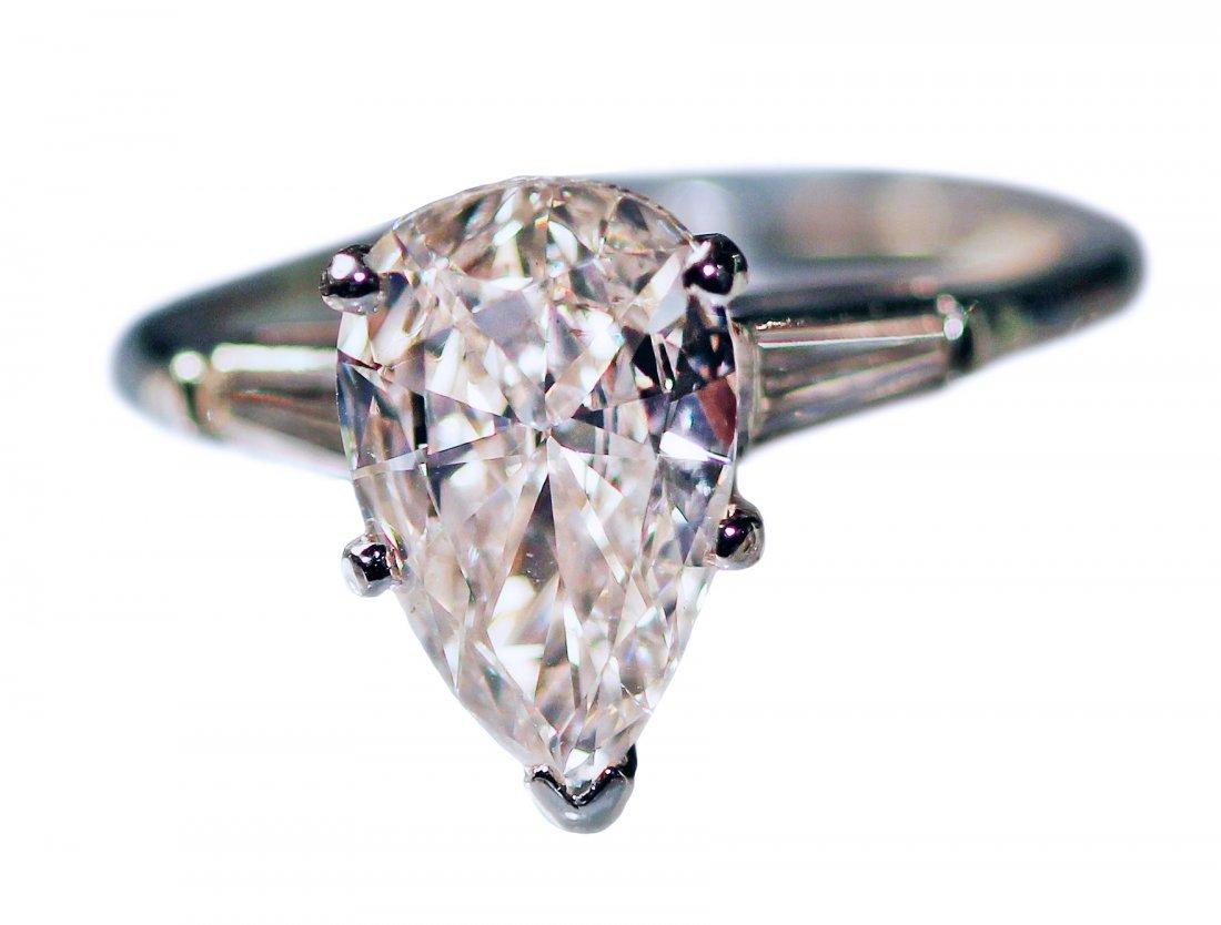 PLATINUM PEAR SHAPED DIAMOND RING.