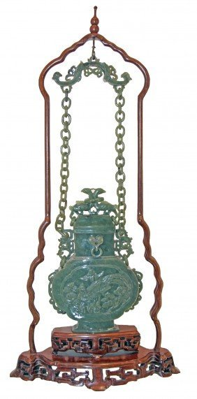 CHINESE HANGING LIDDED JADE VASE ON A WOOD STAND