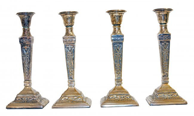 SET OF FOUR GEORGE III STYLE SILVER PLATED CANDLESTICKS