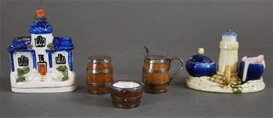 VARIED SALT CELLARS AND A STAFFORDSHIRE COTTAGE