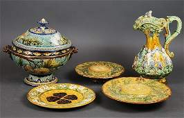 EIGHT VARIOUSLY DECORATED MOLDED MAJOLICA TABLE ITEMS