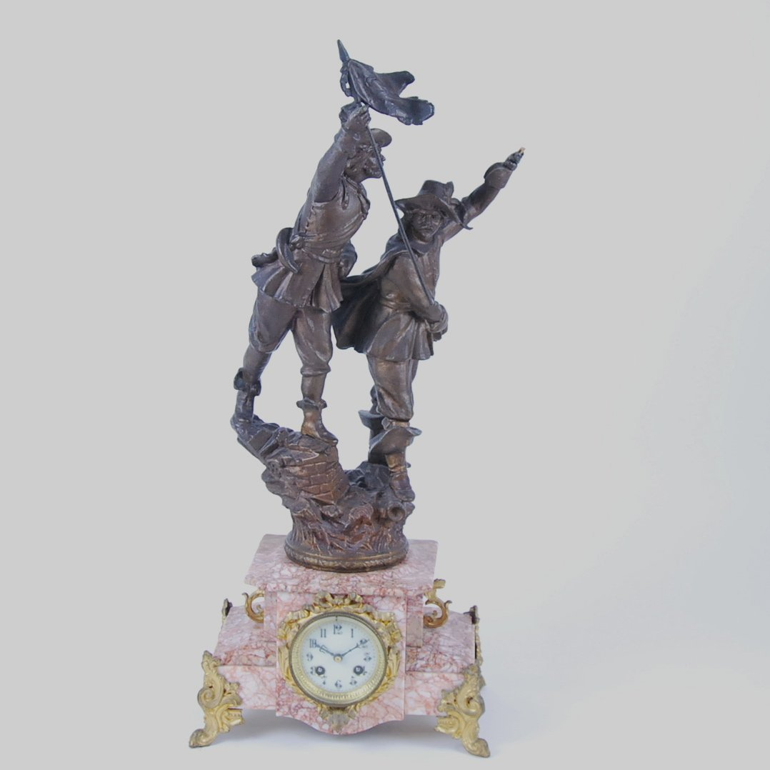PATINATED METAL AND RED MARBLE FIGURAL MANTLE CLOCK