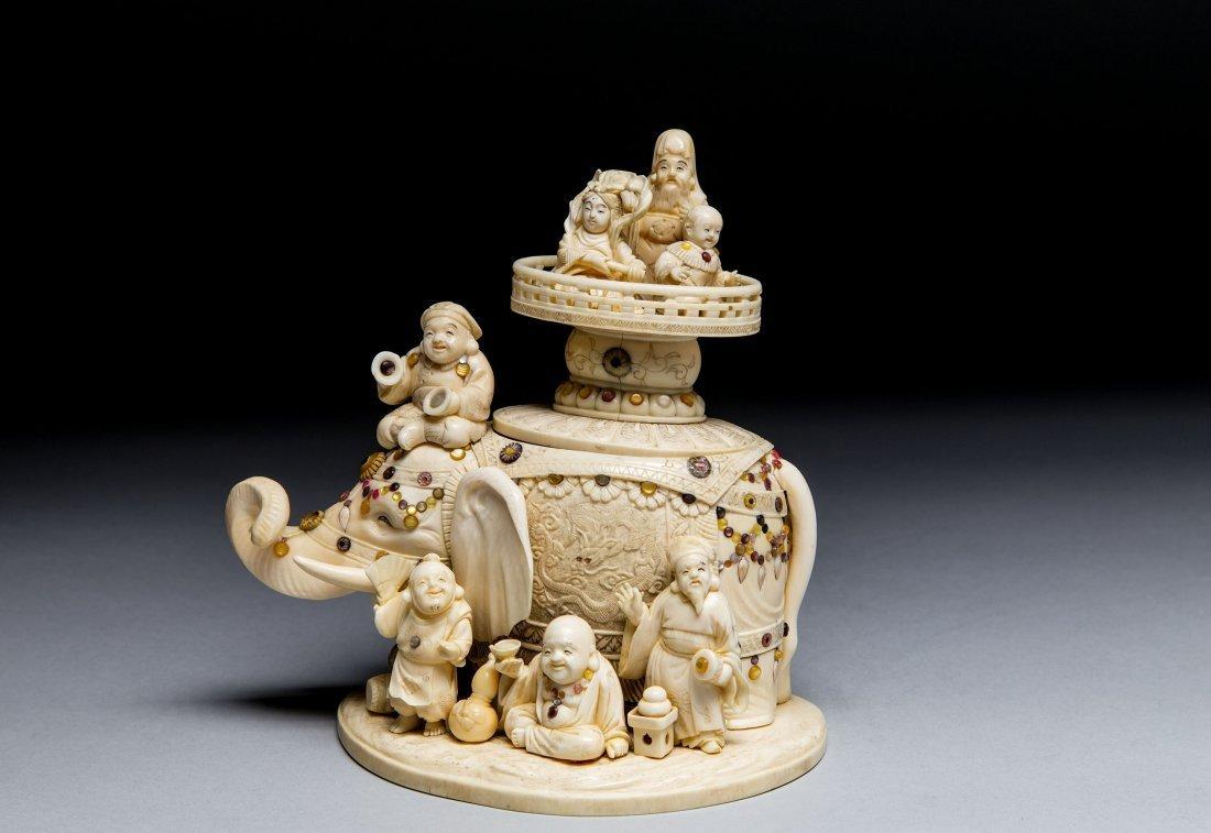 JAPANESE CARVED SHIBIYAMA IVORY ELEPHANT WITH 7 GODS
