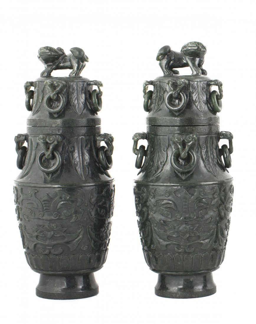 A VERY FINE PAIR OF SPINACH GREEN JADE VASES AND COVERS
