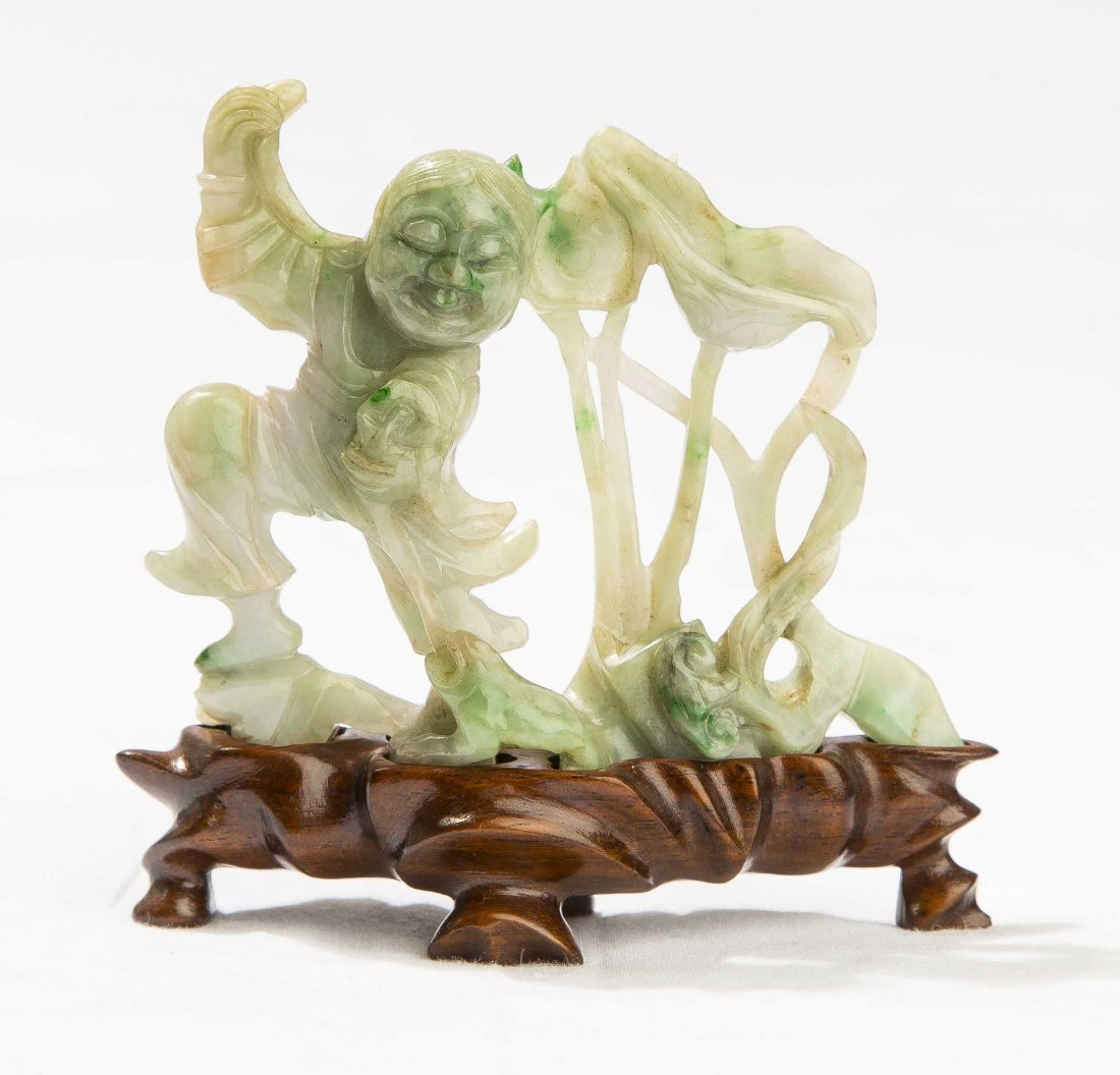 CHINESE JADE FIGURE OF A BOY AND FROG AMIDST LOTUS