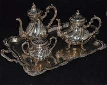 FOUR PIECE STERLING SILVER TEA AND COFFEE SERVICE