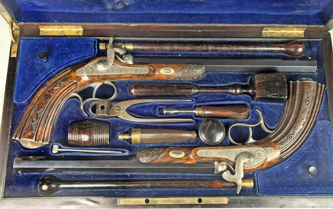 A FINE CASED PAIR OF FRENCH DUELING PISTOLS, CIRCA 1850 - 9