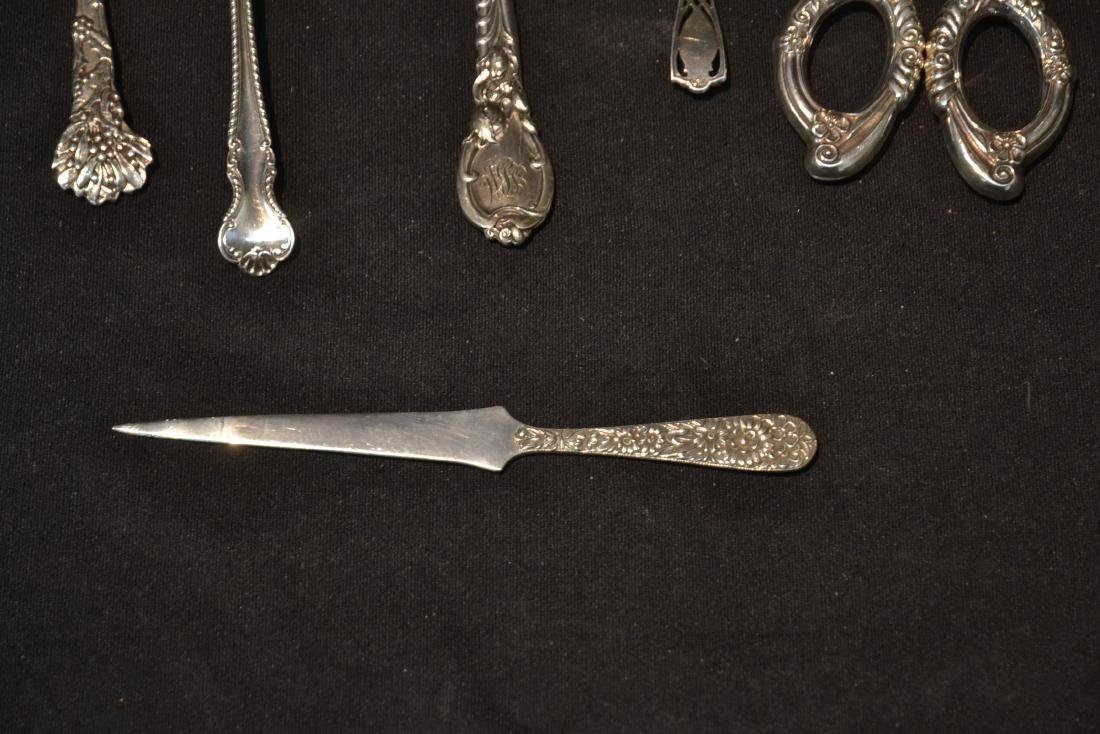 (9)pc STERLING SILVER LOT CONSISTING OF SPOONS - 9