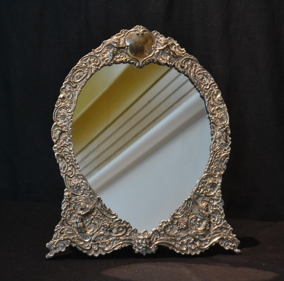 LARGE EMBOSSED STERLING SILVER FRAME WITH