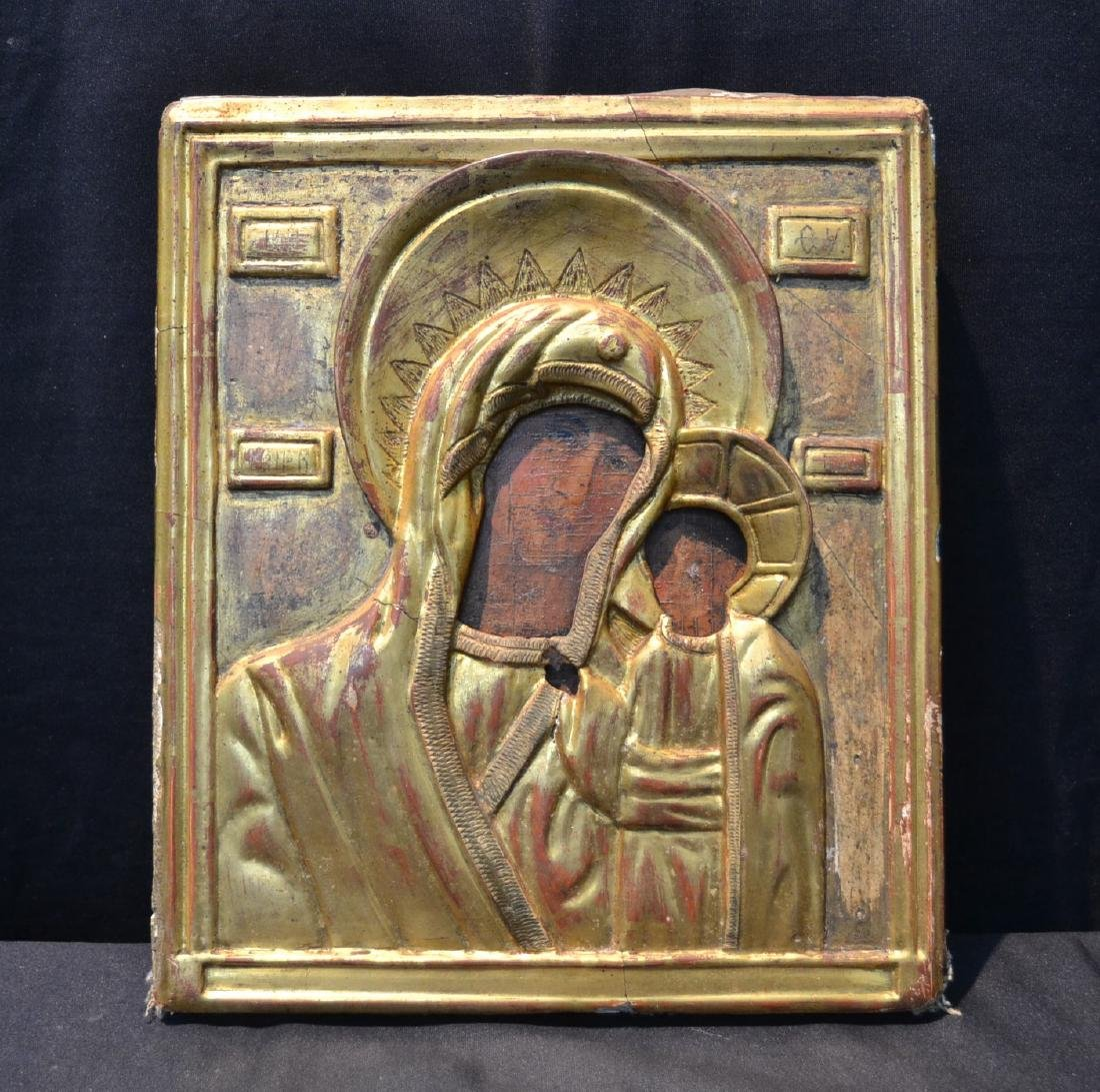 EARLY RUSSIAN ICON WITH CARVED GILT SLEEVE