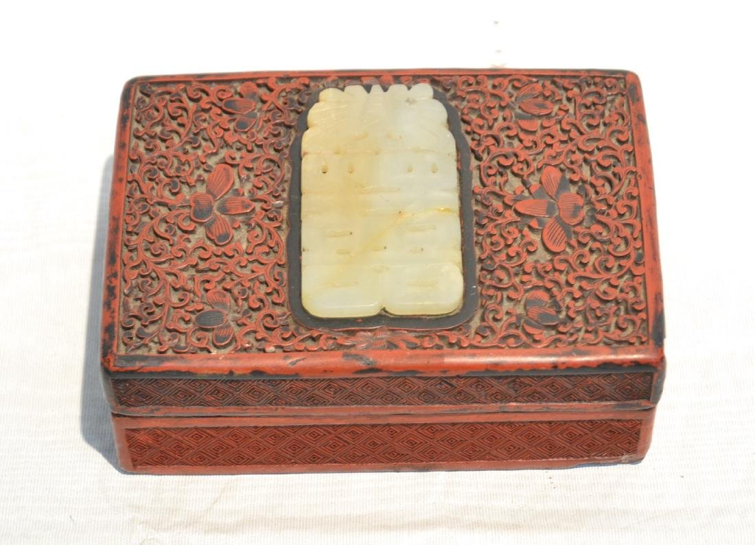 ANTIQUE CARVED CINNABAR BOX WITH JADE INSERT