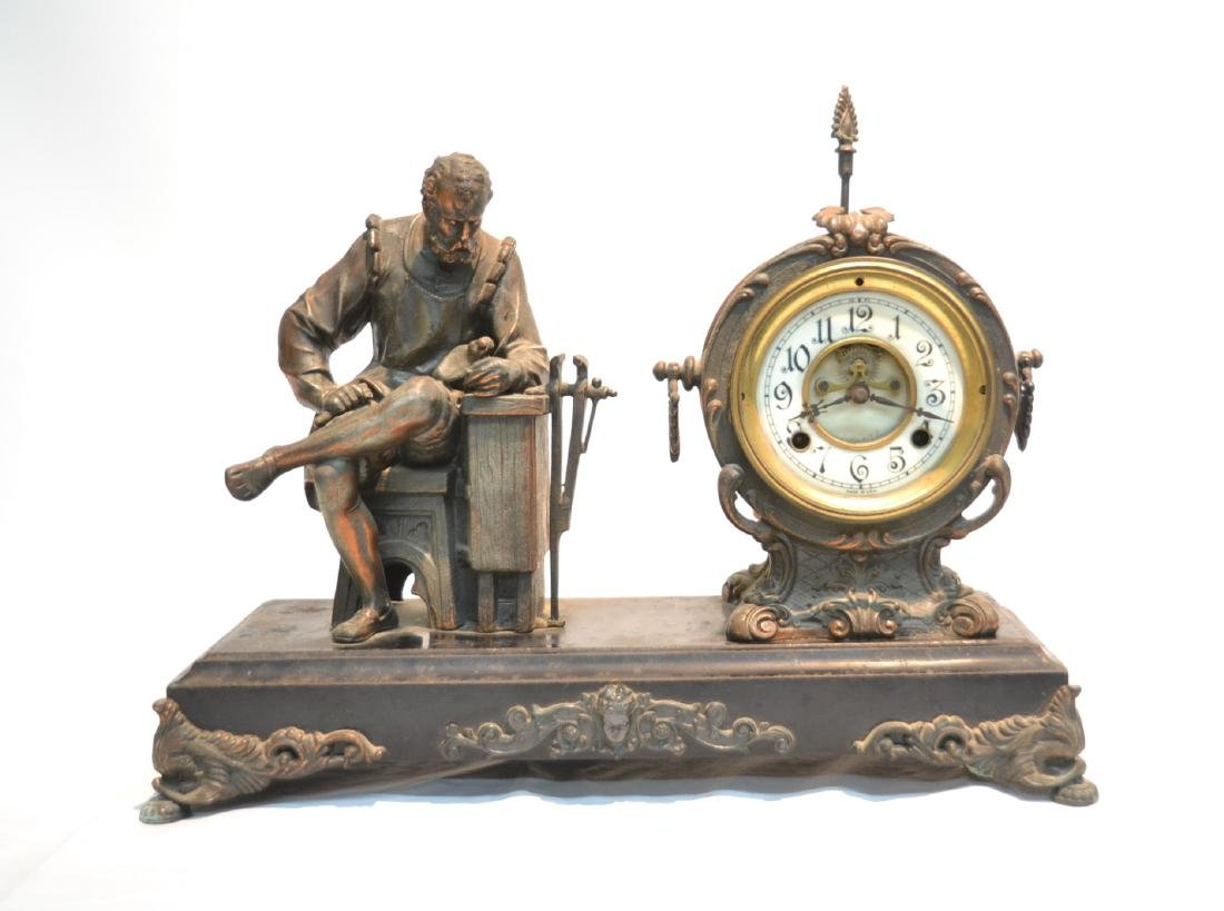 SPELTER CLOCK WITH SEATED FIGURE OF BLACKSMITH