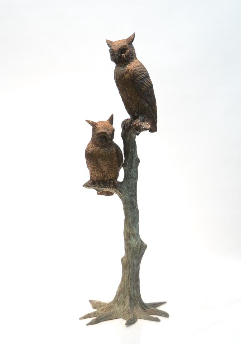 LARGE BRONZE OWLS PERCHED ON TREE