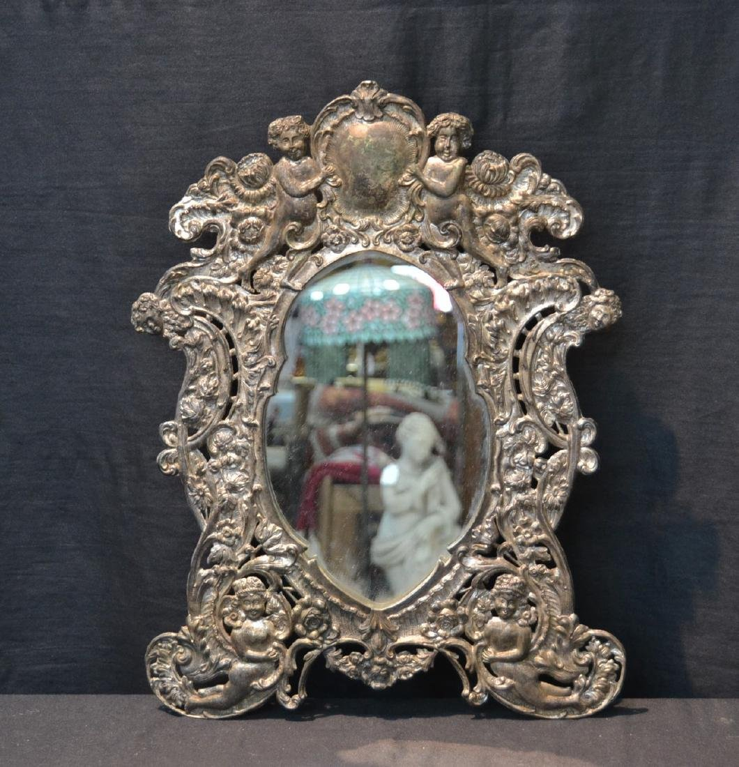 EMBOSSED SILVER PLATE EASEL MIRROR WITH CHERUBS
