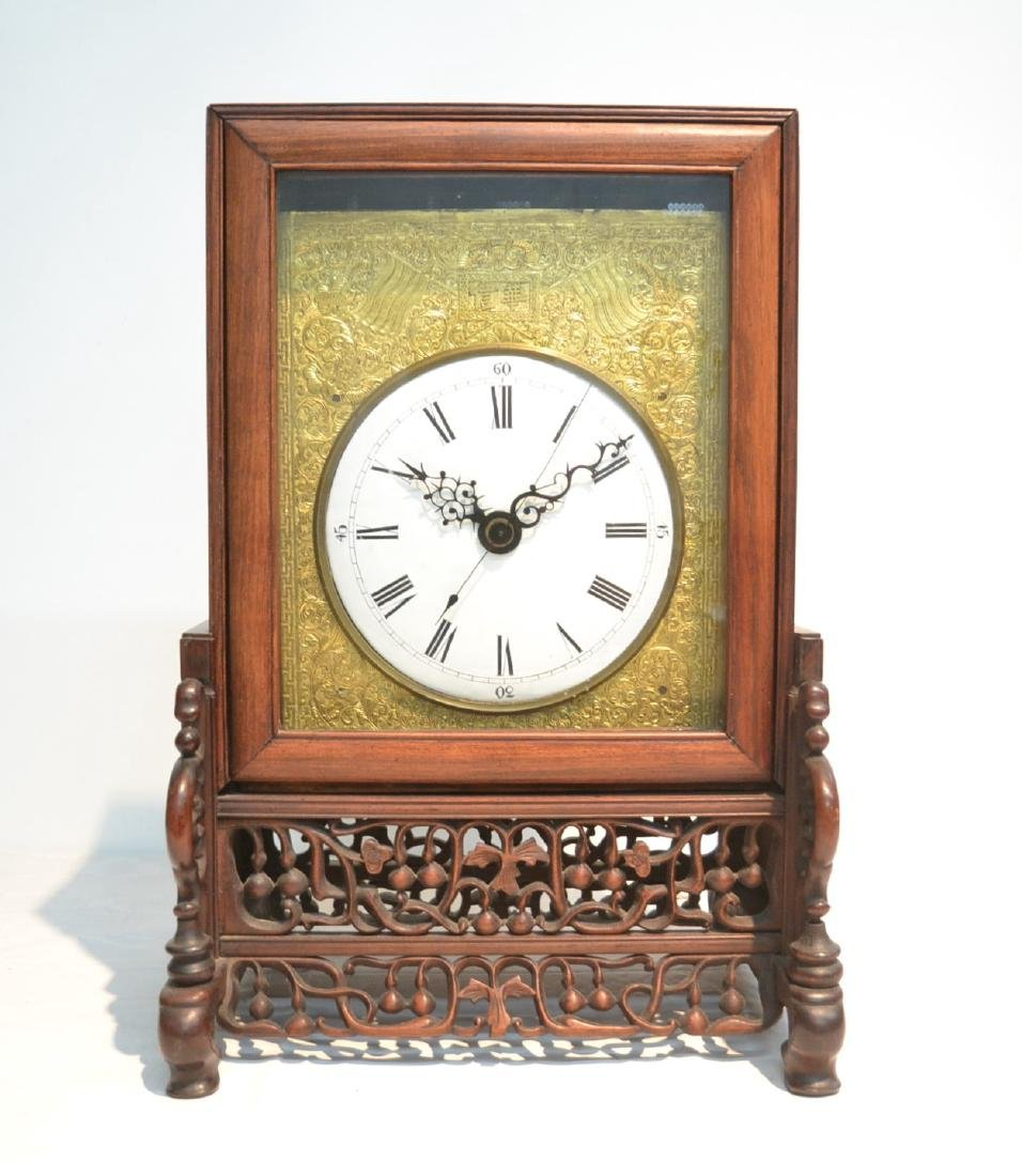 ANTIQUE CHINESE BRASS CLOCK SET IN ORNATELY