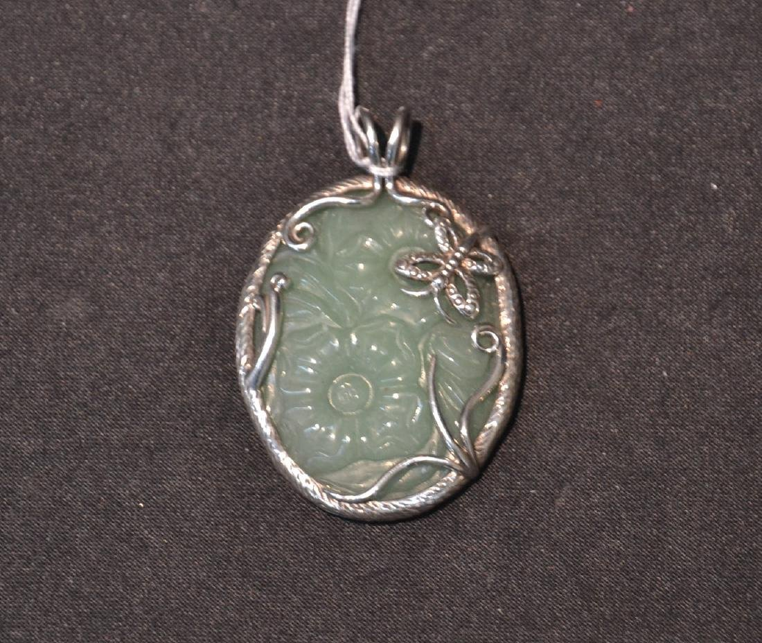 STERLING SILVER & FLORAL JADE PENDANT MOUNTED ON