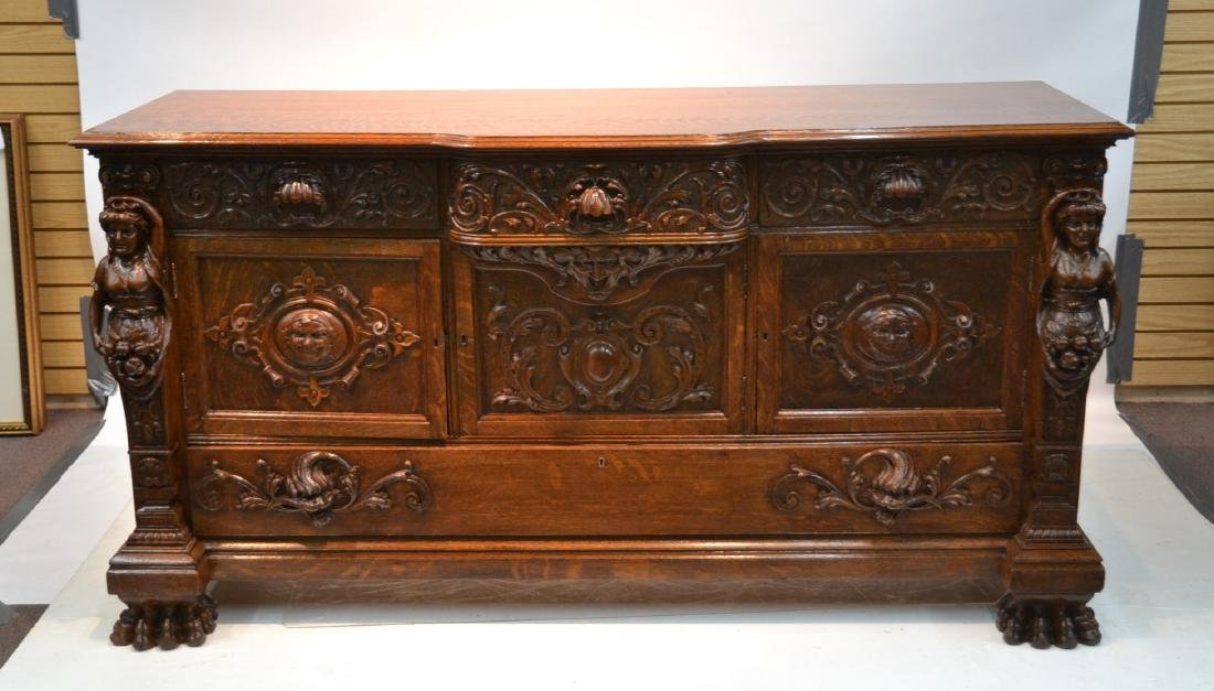 LARGE HEAVILY CARVED TIGER OAK SIDEBOARD