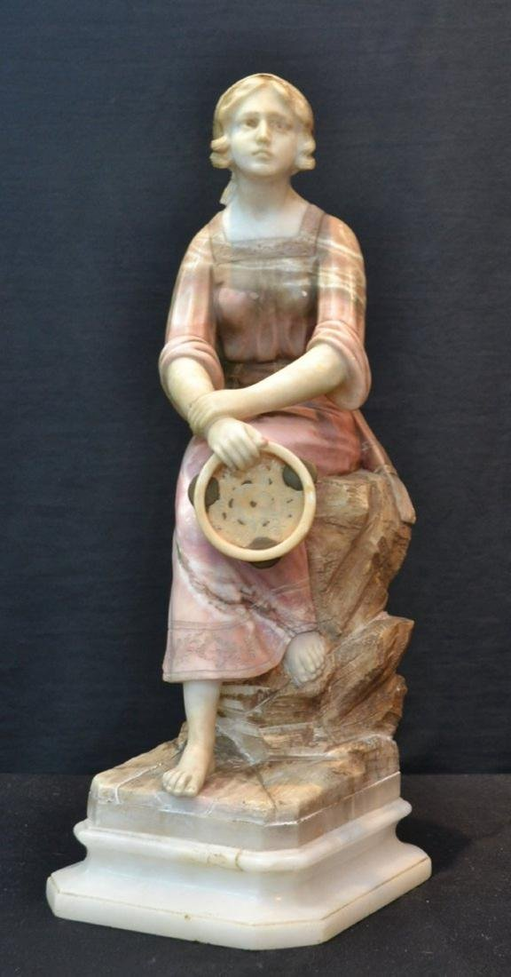 MULTI TONE ALABASTER GIRL SEATED ON ROCKS