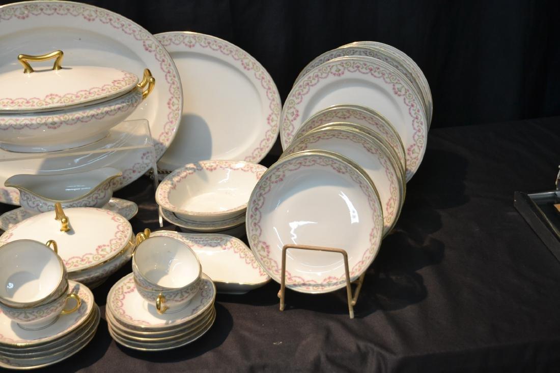 ELITE LIMOGES DINNER SET CONSISTING OF - 4