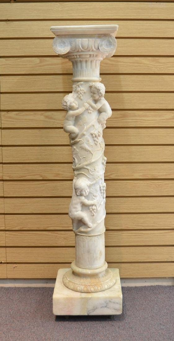 CARVED MARBLE PEDESTAL WITH PUTTIS CLIMBING
