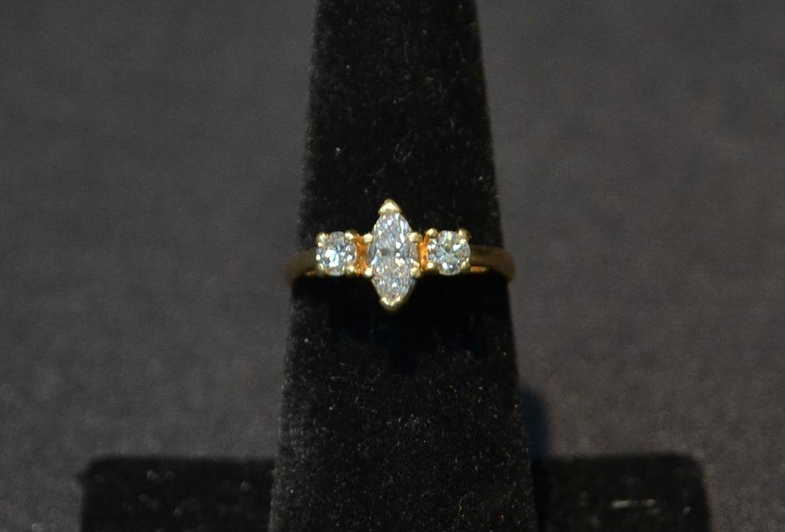 14kt DIAMOND RING WITH APPROXIMATELY 1ct MARQUIS