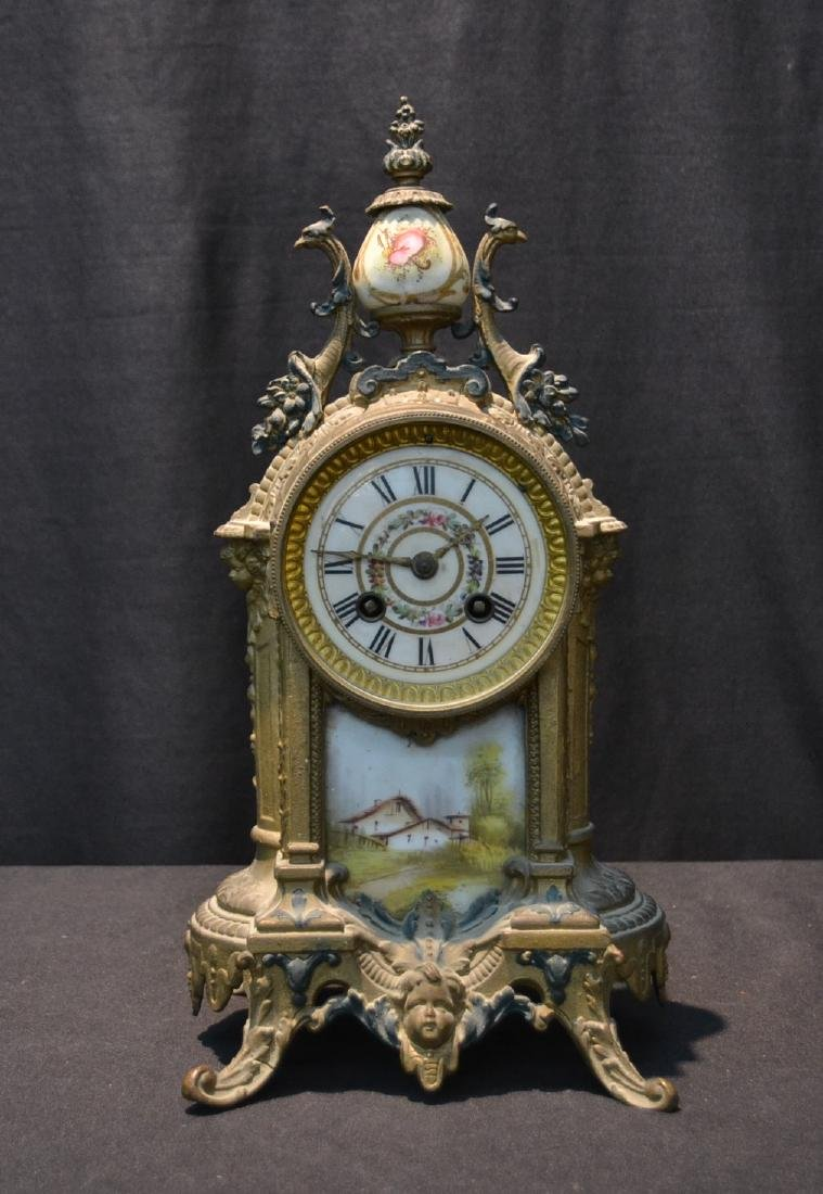 FRENCH GILT METAL MANTLE CLOCK WITH