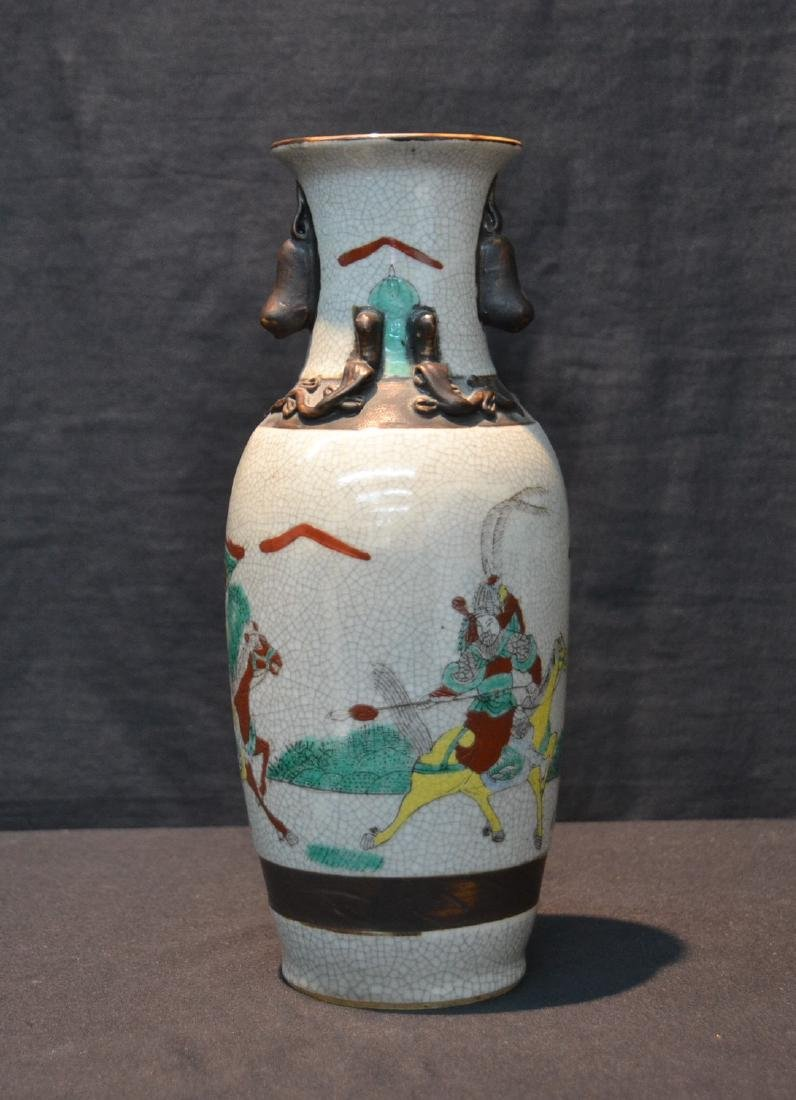 ORIENTAL VASE WITH RAISED FIGURES ON HORSEBACK
