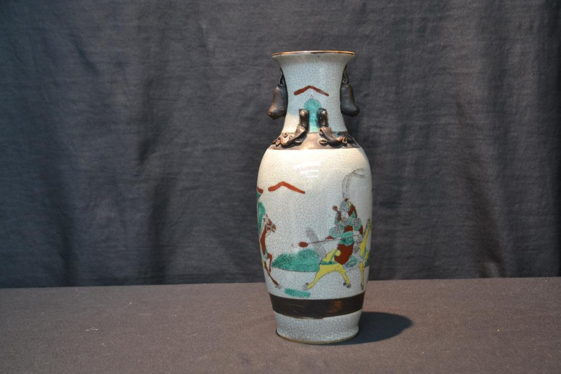 ORIENTAL VASE WITH RAISED FIGURES ON HORSEBACK - 2