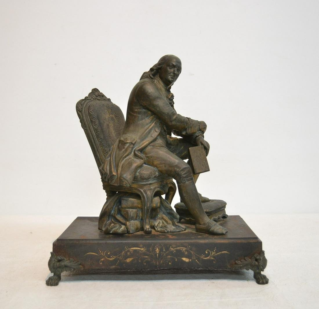 WHITE METAL SCULPTURE OF SEATED BEN FRANKLIN