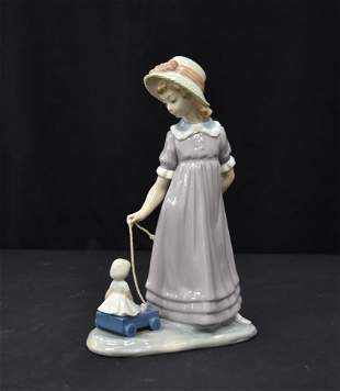 LLADRO GIRL WITH DOLL IN WAGON