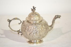 19thC EMBOSSED SILVER TEA POT WITH SCENES