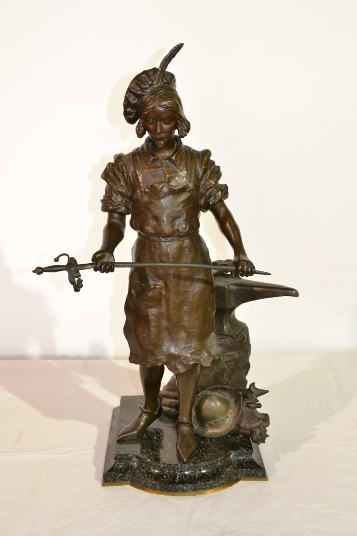 295: LARGE BRONZE SCULPTURE OF SILVER SMITH ON