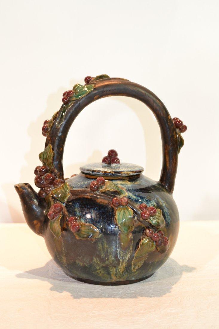 211: MAJOLICA STYLE POTTERY TEA POT WITH RAISED
