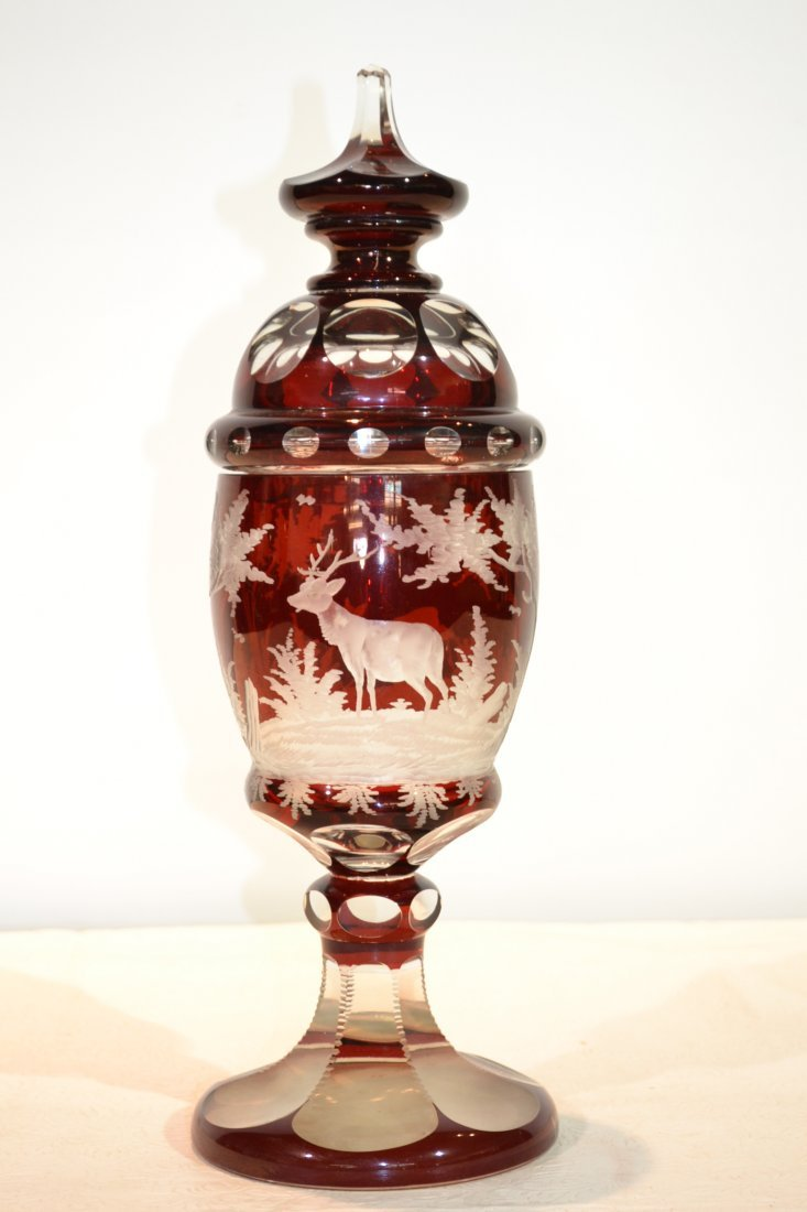 202: RUBY BOHEMIAN COVERED JAR WITH ETCHED DEER &