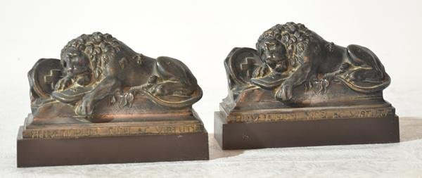 (Pr) CARVED METAL RECLINING LIONS ; MARKED