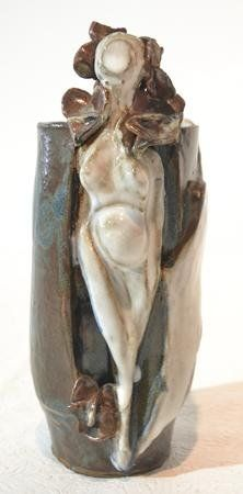 FIGURAL POTTERY VASE WITH FACELESS NUDE WOMAN